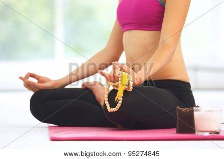 Young Woman Meditating In Lotus Pose.