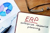 Notepad with Enterprise Resource Planning System (ERP)  on office wooden table. poster