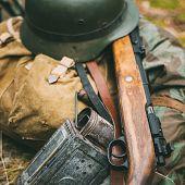 German military ammunition of World War II on ground. Military helmet, lights, rifle Mauser Karabiner 98k poster