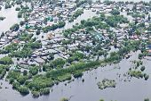 Ob River Flood June 2015 Aerial View of same houses in vicinity of Nizhnevartovsk, Tyumen region, Russia. Aerial view of the residential area of the suburb of Nizhnevartovsk during the flood of 2015. poster