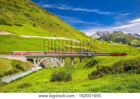 The Matterhorn - Gotthard - Bahn On The Bridge Viaduct Near Andermatt.