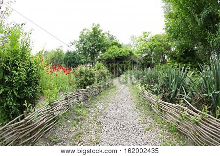 Path to alcove in garden
