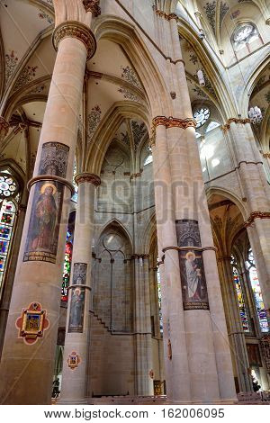 Trier, Germany - April 26, 2016. Interior view of Liebfrauenbasilika church in Trier, the oldest Gothic church in Germany, with pillars symbolizing apostles.