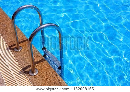 entrance to the swimming pool with metal railings