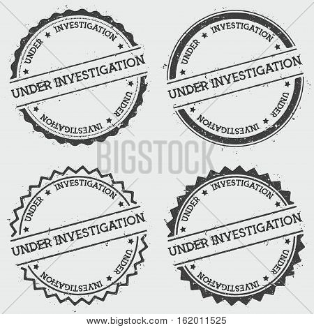 Under Investigation Insignia Stamp Isolated On White Background. Grunge Round Hipster Seal With Text