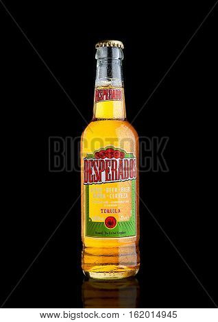 LONDON UK - DECEMBER 15 2016: Bottle of Desperados beer lager flavored with tequila is a popular beer produced by Heineken and sold in over 50 countries.