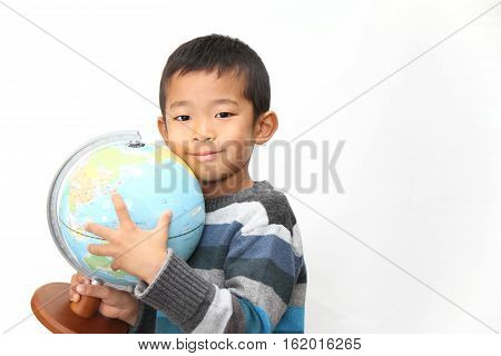 Globe and Japanese boy (first grade at elementary school)
