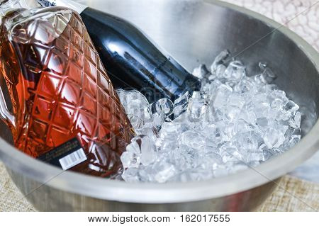 Set of Alcohol bottles in an ice bucket