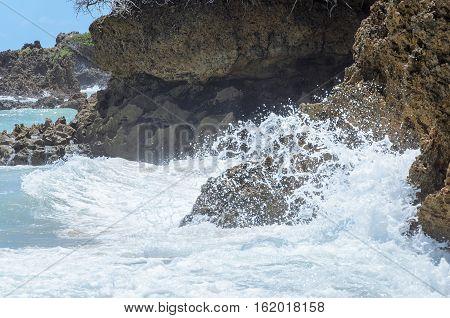 Sea Water Hitting Stones Background. Rough Seas In Beach Coqueirinho, Joao Pessoa Pb, Brazil.