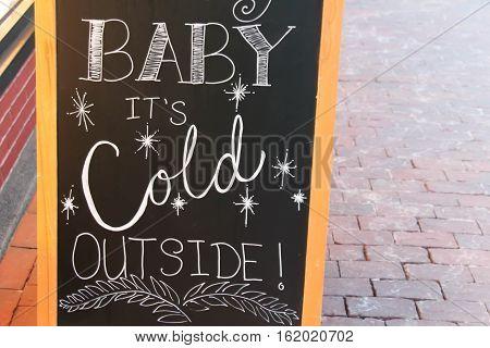 baby its cold outside on sidewalk chalkboard