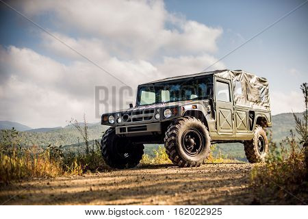 VLADIVOSTOK, RUSSIA - SEPTEMBER 22, 2015: Motor car Toyota Mega Cruiser driving on a forest road