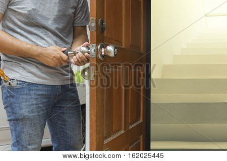 locksmith open the wood door by cylinder tools to cement stair - can use to display or montage on product
