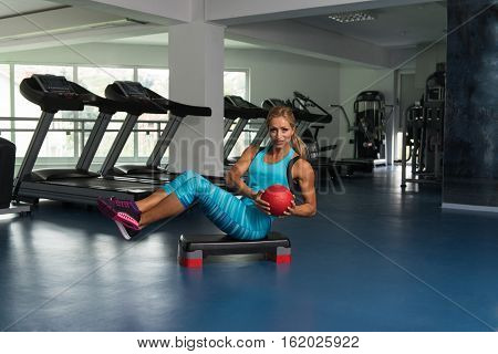 Woman Doing Abdominal Exercise With Ball On Stepper