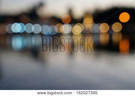 Abstract multicolor blurred bokeh light with water reflection