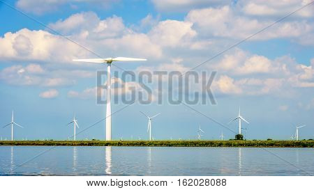 Wind Farm with Two and Three bladed Wind Turbines along the Shore of Veluwemeer in the Netherlands