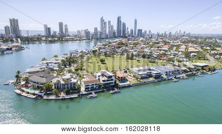 Aerial view facing south of Cronin Island waterfront properties and Surfers Paradise Gold Coast in the horizon. poster