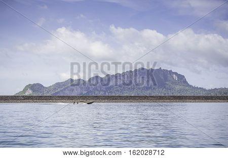 Beautiful mountain with blue sky at chiewlarn dam or ratchaprapa dam Suratthani Thailand.