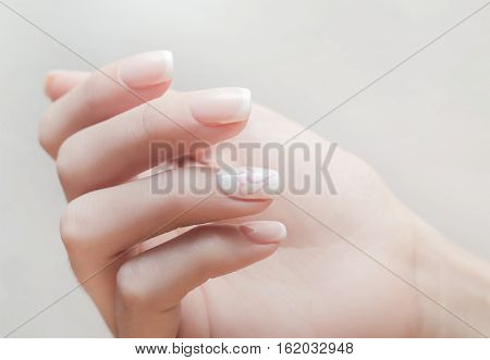 Nails saloon woman applying nail polish gel