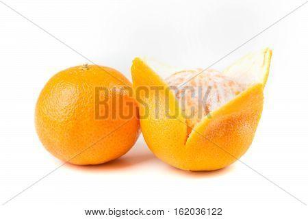 Two Navel Oranges One Peeled One Unpeeled Isolated On White Background