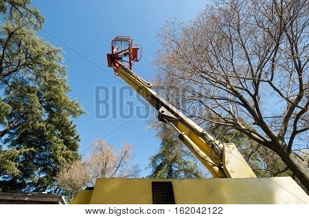 Diesel Powered Articulating Boom Lift in a park poster