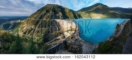 The Enguri hydroelectric power station HES. The wide Inguri River Jvari Reservoir next to Enguri Dam surrounded by mountains Upper Svaneti Georgia. One of the highest concrete arch dam in the world. Jvari location.