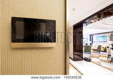 intercom video door bell on the wall outside modern living room