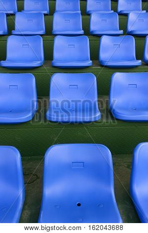 lines of blue stadium seats vertical composition
