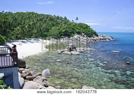 asian girl tourist with backpack enjoying view of idyllic white beach in lamai koh samui thailand