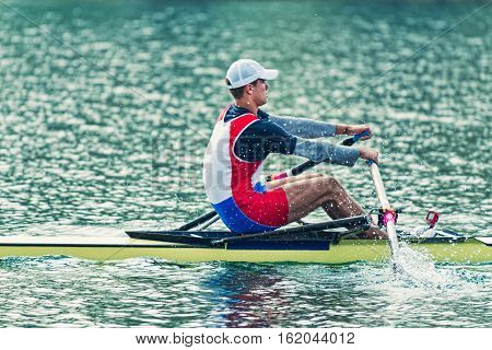 Single scull sport rowing, toned image, horizontal