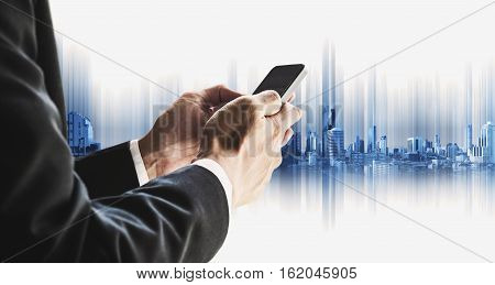 Businessman using smartphone with city, business communication technology concepts