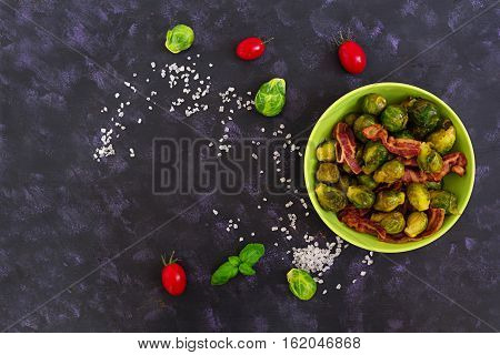 Roasted Brussels Sprouts With Bacon On Dark Background. Top View
