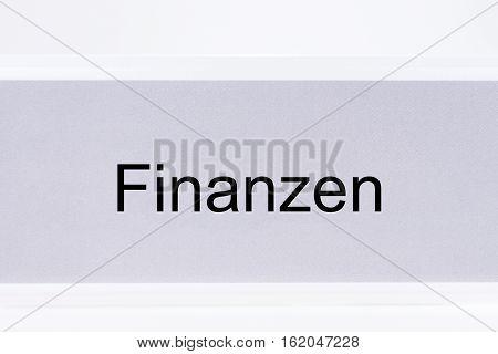 File folder Finances (Finanzen) in German language on white background