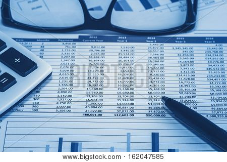 Accounting financial bank banking account stock spreadsheet data for accountant  with glasses pen and calculator in blue analysis analyst analyzer