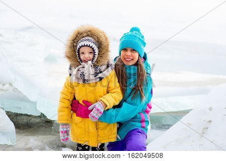 Group Of Young Girls Sitting At The Ice Block