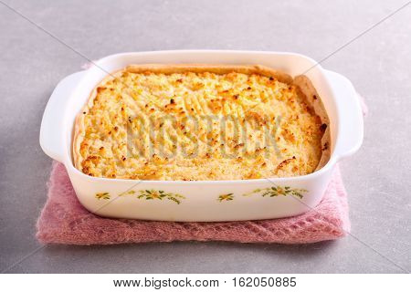Cottage pie in a tin on table