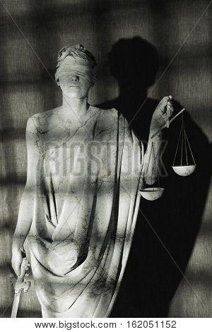 woman depicting Nemesis behind a prison bars