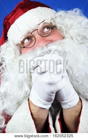 Santa Claus In The Christmas Night Praying