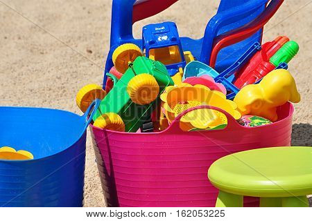 Detail view of a colorful plastic toy on the sandpit