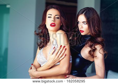 Sexy woman in underwear with her lesbian dominatrix lover