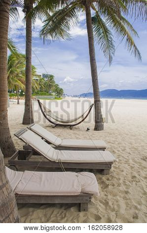 Sunbeds, Hammock And Palms In The My Khe Beach, Danang, Vietnam