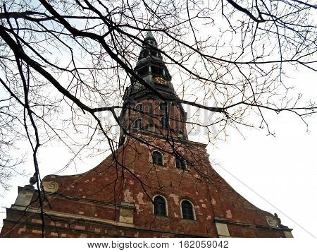 The tower of St. Peter's Church in Old Riga against the sky, December 2016 in Latvia