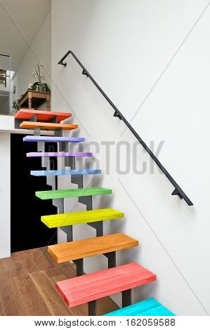 Multi Colored Hardwood Stairs Modern Living Room