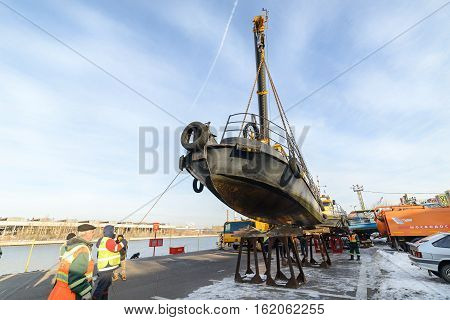 MOSCOW, RUSSIA - NOVEMBER 11, 2016: State Unitary Enterprise Mosvodostok performs recovery vessels on coastal winter parking. Installation work on the shores of the vessel.