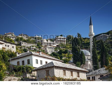 scenic view of pocitelj village traditional old architecture buildings and mosque in Bosnia Herzegovina