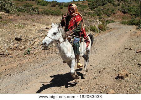 An Ethiopian Horse Men is riding a Horse