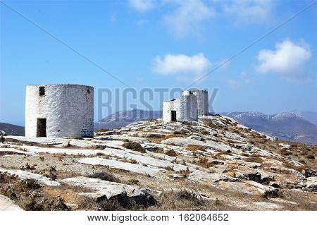 Old stone windmills on a rugged mountaintop