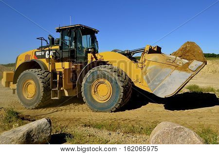 HAWLEY, MINNESOTA, August 4, 2016; Founded in 1925, the 982 M Cat carrying sand is from Caterpillar Inc., an American corporation which designs, develops, engineers, manufactures, markets and sells machinery, engines, financial products and insurance