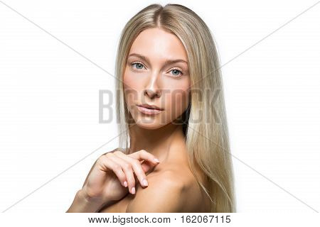 Beautiful young woman with straight blond hair and natural make up touching face. Isolated on white. Copy space.
