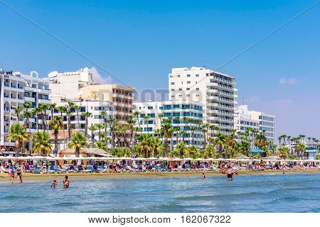 LARNACA CYPRUS - AUGUST 27 2016: Finikoudes Beach with the numerous hotels and cafes on the background.