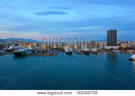 View on the port in Piraeus with ships and boats in the evening. Athens Greece - 24.04.2016.